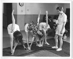 [Photograph of a Group of Women Stretching]
