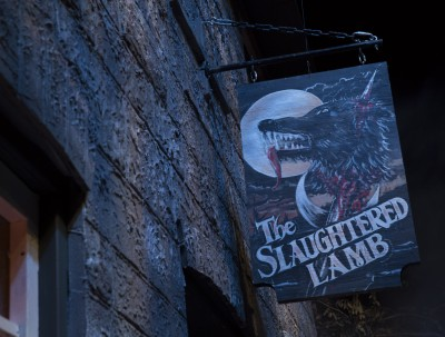 The Bar is called The Slaughtered Lamb. The hanging sign depicts a skewered wolf's head