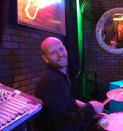 Shay Eischen playing drums