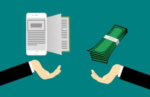 seller's hand on the left with ebooks and buyer's hand on the right with cash