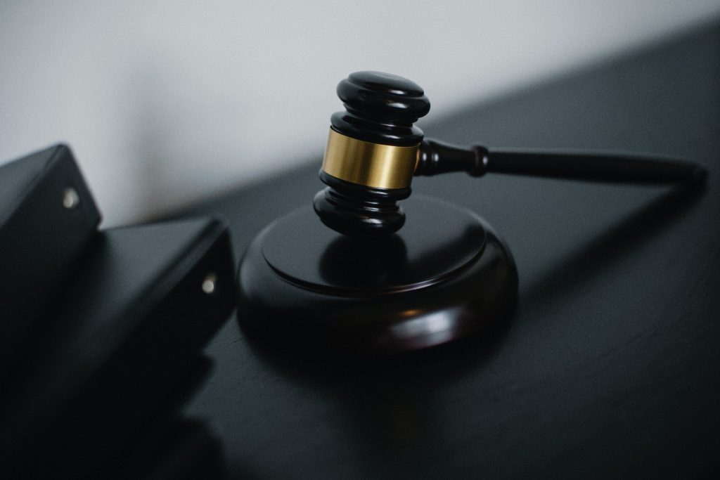 Small judge gavel placed on table