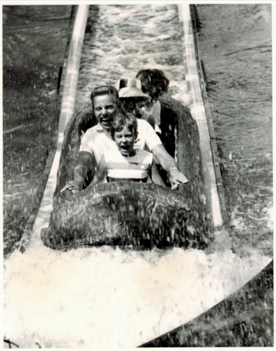 "Arlington, TX: Shot of guests riding the El Asseradero located in the Spanish Sector of Six Flags Over Texas. El Asseradero, which translates to ""Saw Mill"" in English, was the first of its kind in the world to be constructed in 1963."