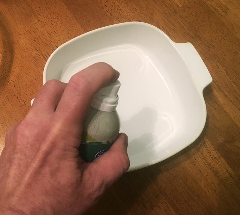 Applying a coat of oil to the pan