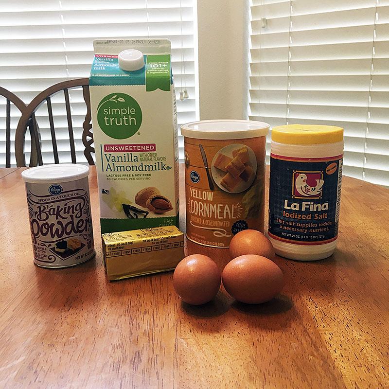 Spoon bread ingredients: sweet milk, corn meal, butter, eggs, baking powder, salt