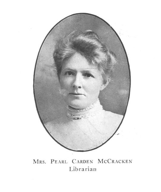 "oval with black and white photograph of bust of a woman with hair up and high collar ruffled top. below is text with her name and positions ""Mrs. Pearl Carden McCracken, Librarian"""
