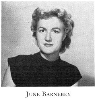 Black and white portrait photo of a white woman with short curled hair. She wears a black shirt and has a slight smile. Below is the text, June Barnebey.