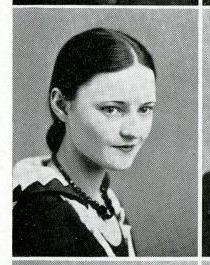 Black and white photograph of a woman with hair pulled back.