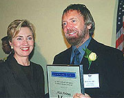 Hillary Clinton presents the National Heritage Fellowship to Mick Moloney