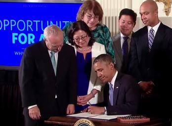 President Obama signing Executive Order 13672